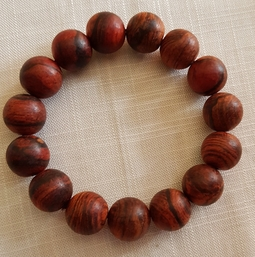 Vòng đeo tay gỗ Sưa dây 14li